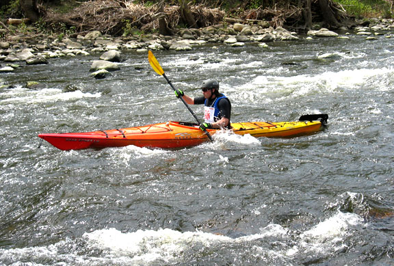 Dan Ney kayaks through some rapids on the Naugatuck River during the 4th annual Naugatuck Valley River Race May 7. PHOTO BY ELIO GUGLIOTTI