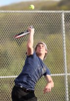 Naugatuck's John Dana reaches for the ball during a doubles match against Crosby May 9. - PHOTO BY LARAINE WESCHLER