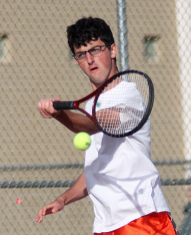 Naugatuck's Jake Burrel reaches for the ball during a doubles match against Crosby May 9. - PHOTO BY LARAINE WESCHLER