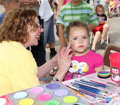 Nancy Haack paints a butterfly on Sohpia Rose Drown, 3, at Naugatuck Duck Day June 5.
