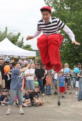 Rob Lok, right, with Cirque Du Jour, jumps rope with the help of Jenna Miller at Naugatuck Duck Day June 5.
