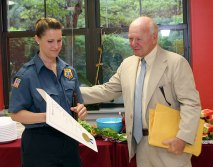State Sen. Joe Crisco, right, recognized EMT Anna DeFelice for her role in saving a Naugatuck resident's life.