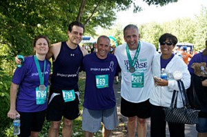 From left, Genie Tricarico, Dino Verrelli, Shane Behrle, Leo Disorbo, and Loretta Lesko pose after running with Team Project Purple at the Amica Iron Horse Half Marathon on June 5th in Simsbury.