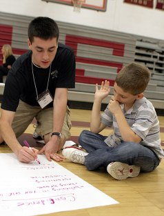 Mike DeCerbo, left, asks his group, including Ryan Shemanaski, right, what it means to be a leader. The group discussed the importance of confidence in leadership.