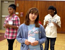Lilliana Roma, center, acts out a skit about honesty, one of the qualities her group identified in leaders.