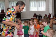Les Julian teaches his young audiance a dragon dance during his children's concert, We All Laugh in the Same Language, July 7 at the Prospect Fire House. The concert was hosted by the Prospect Public Library.