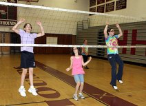 Campers practice running towards the net and jumping.