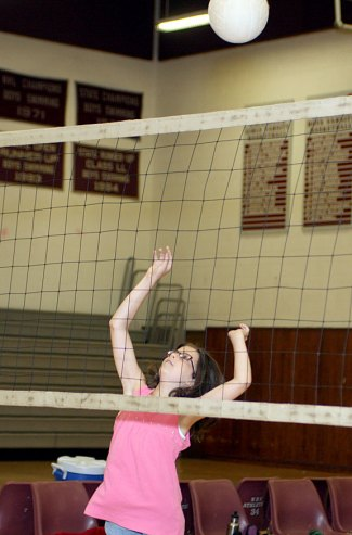 Kaleigh Gelinas, 11, goes for the ball at the Parks and Recreation Department sponsored volleyball camp at Naugatuck High School July 14.
