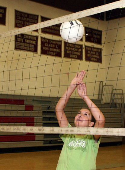 Nicole Healy, 12, goes for the ball at the Parks and Recreation Department sponsored volleyball camp at Naugatuck High School July 14.