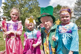 From left, Olivia Graffam, 6, Sophia Graffam, 3, Mayor Robert Chatfield as the Mayor of Emerald City from the Wizard of Oz, and Alexis Graffman, 5, dressed up for character day at End of Summer Fun Week on the Prospect Town Green Aug. 22. The day featured face painting, train rides, and ice cream.