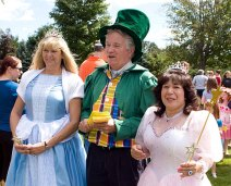 From left, Cher Brooks, as Cinderella, Mayor Robert Chatfield as the Mayor of Emerald City from the Wizard of Oz, and Monica Robinson as Glinda, dressed up for character day at End of Summer Fun Week on the Prospect Town Green Aug. 22. The day featured face painting, train rides, and ice cream.