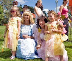 From left, Blake Rankin, 4, Cher Brooks, Monica Robinson, and Maggie Sandora, 3, dressed up for character day at End of Summer Fun Week on the Prospect Town Green Aug. 22. The day featured face painting, train rides, and ice cream.