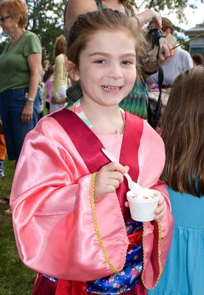 Maura Bletrami enjoys ice cream during character day at End of Summer Fun Week on the Prospect Town Green Aug. 22. The day featured face painting, train rides, and ice cream.