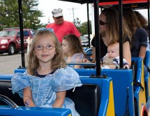 Nina Hopson, 4, enjoys a train ride during character day at End of Summer Fun Week on the Prospect Town Green Aug. 22. The day featured face painting, train rides, and ice cream.