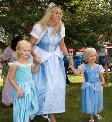 From left, Cora Cwiertniewicz, 4, Cher Brooks, and Ava Cwiertniewicz, 2, dressed up for character day at End of Summer Fun Week on the Prospect Town Green Aug. 22. The day featured face painting, train rides, and ice cream.