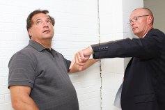 Burgess Ron SanAngelo, left, and David King of Kaestle Boos Associates inspect cracks along the wall during an Aug. 25 tour of Naugatuck High School.