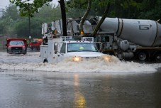 A town utility vehicle makes its way through a large pool of water along Railroad Avenue in Beacon Falls. - CONTRIBUTED
