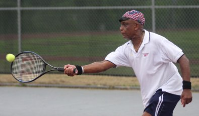Above, Tom Powell of Naugatuck returns a shot July 29 during the Naugatuck Tennis Open. Powell won the match to go on to win the men's senior championship.