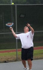 Ed Carter, the tournament's organizer, serves up a shot against Tom Powell of Naugatuck during the Naugatuck Tennis Open July 29.