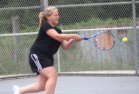 Naugatuck High School graduate Meghan Toth practices her tennis skills with her dad during the Naugatuck Tennis Open July 29 at Naugatuck High School.
