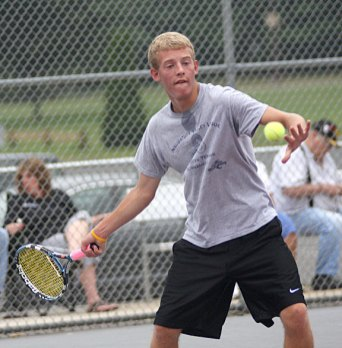 Jimmy Tompkins of Prospect keeps the rally alive versus Naugatuck's Randy Burell, not pictured, in an extra season match July 29. Burell went on to win the men's junior championship.