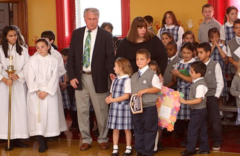 St. Francis-Hedwig School students watch a ceremony blessing the new Naugatuck school Wednesday morning.