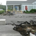 Hurricane Irene further damaged the entrance to Mountview Plaza and Webster Bank from Rubber Avenue, but a lawyer representing the company that owns the shopping center said they could begin fixing it within the month. - RA ARCHIVE