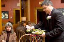"""Naugatuck Mayor Robert Mezzo, right, serves Janet Hall from Griffin Hospital during the """"Waiters go Pink"""" fundraiser at Jesse Camilles Restaurant Monday night."""