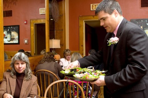 "Naugatuck Mayor Robert Mezzo, right, serves Janet Hall from Griffin Hospital during the ""Waiters go Pink"" fundraiser at Jesse Camilles Restaurant Monday night."
