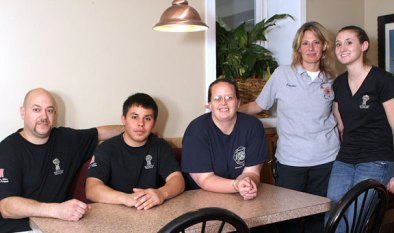From left, Pete Hatzidimitriou, owner of Beacon Falls Pizza Palace, pizza maker Rene Molina, EMT Martha Burge, firefighter Gretchen Carlson, and firefighter and waitress Susan Leeper pose at the restaurant during the 'tip a firefighter' fund-raiser Oct. 19. The event raised money for organizations supported by Beacon Hose Company No. 1, including Boy Scouts, the Senior Center, scholarship funds, and food banks. Hatzidimitriou prepared a special porketta dinner for the event, while firefighters waited tables for tips. 'We're hoping to bring people in to help (the Pizza Palace) and help us,' said Ken George, special events chair for the fire company.