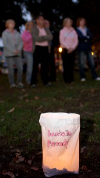 A luminaries honors Naugatuck Police Officer Danielle Parady, who is currently battling cancer, Monday night on the Town Green to kick off The Valley Goes Pink month.