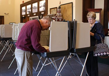 Voters cast their ballots for the High School renovation referendum at the Naugatuck Historical Society Museum Tuesday. The referendum passed 1,756 to 944.