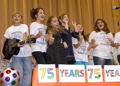 Community School in Prospect celebrated its 75th anniversary Wednesday with a ceremony that included opening a time capsule from 1986 and student performances from each decade the school has existed.