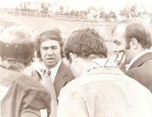 Former Naugatuck head coach Craig Peters discusses strategy with longtime assistant Bob Harrison during a 1975 game at Shelton.