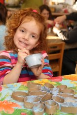 Chloe Walsh, 4, makes a cardboard snowflake as part of an arts project taught by Program Librarian Meg Gill Dec. 29 at the Beacon Falls Public Library.