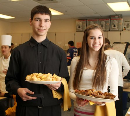Junior James Barrett, left, and sophomore Rebecca Moscato, serve hors d'oeuvres for a culinary class at Woodland Regional High School Monday morning. - LARAINE WESCHLER