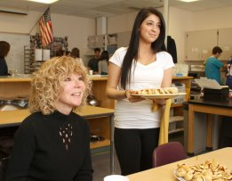 Woodland junior Semra Zekiri serves parent Sue Barrett hors d'oeuvres for a culinary class at Woodland Regional High School Monday morning. - LARAINE WESCHLER