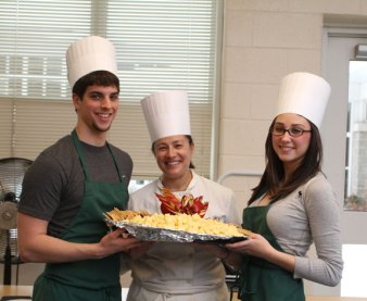 From left, senior Patrick O'Dell, teacher Catherine Mirabilio, and junior Hailey Filippone show off hors d'oeuvres they prepared for a culinary class at Woodland Regional High School Monday morning. - LARAINE WESCHLER