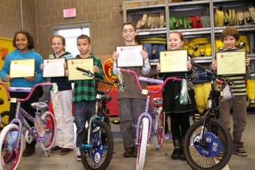 Winners of the Naugatuck Fire Department's 6th Annual Connecticut Fire Prevention Poster Contest, from left, Kimani Grey, Hailey Russell, George Cruz, Raymond Lucarelli, Michaela Turecek, and Trey Generali, show off their certificates and prize bike following an awards ceremony Feb. 1 at the Naugatuck Fire Headquarters. The fourth and fifth grade first place winners will go on to compete in a state-wide contest.