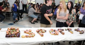 Eighth grade students participate in Cupcake Wars March 22 during Long River Middle School's spirit week. The two teams, blue and yellow, had half an hour to decide on a theme and decorate cupcakes to represent that theme. This was Long River's first spirit week and it culminated in a pep rally. – LUKE MARSHALL