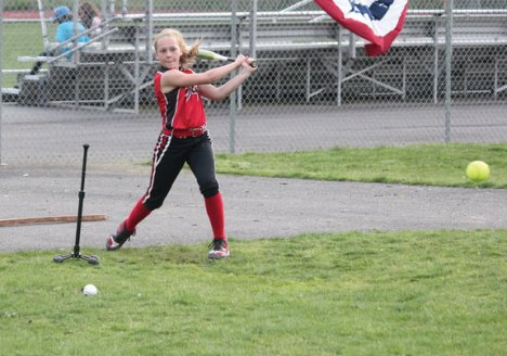 Allison Klimaszewski, 12, of Naugatuck cracks a hit during Major League Baseball's Pitch, Hit & Run competition May at Naugatuck High School. The borough hosted the competition for the fourth year. Youth from Naugatuck and surrounding communities competed in pitching, hitting, and running contests for the opportunity to move on to the sectional round. – Photo by Elio Gugliotti