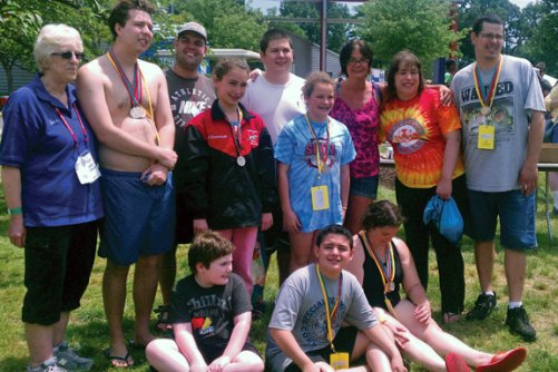Naugatuck Special Olympics competed in the Summer Games held at Southern Connecticut State University on June 9 and 10 bringing home medals and ribbons. The athletes competed in swimming events including the freestyle, backstroke, relays, and breaststroke. Pictured, sitting, Dyllan Siegmund, Julian Giraldo, and Rebecca Barnes. Standing, coach Nancy Lagrave, Jamie Crawford, Jake Segla, Dia Gawronski, Dan Renzoni, Jordan Theroux, Patty Capozziello, Rebecca Ferrari, and Clinton Scheithe.