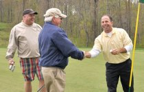 Rob Nocera, right, won a hole-in-one contest during the Naugatuck Chamber of Commerce and YMCA's 18th Annual Golf Outing at Oxford Greens in Oxford, April 24. Nocera, of the Waterbury Housing Fund, won a 2005 Dodge Ram RumbleBee Limited Edition. Pictured with Nocera are Keith Sullivan of Zackin Zimyeski Sullivan C.P.A. LLC and Alex Bequary of Webster Bank.