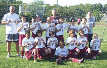 The Naugatuck Youth Soccer U11 boys won the championship in their age division the weekend of May 19 and May 20 at the Clinton Invitational Tournament. Pictured, bottom row, from left, Arthur Tomaz, Efrim Meca, Alex Teixeira, Aren Seeger, Logan Martin, Jake Corbo, and Michael Salomoni. Top row, from left, Justin Simoes, Andrew Mahler, Carlos Gonzaga, Tommy Martins, Rami Fayad, and Christian Jacobi. Coaches, from left, John Jacobi, Al Teixeira, and Scott Corbo. –CONTRIBUTED