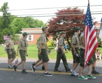Boy Scouts from Prospect Troop 258 march in Prospect's Memorial Day Parade. Prior to the parade, scouts and troop members assembled American flags, which were placed on utility poles throughout town.