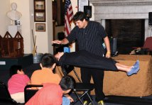 Chris Lengyel, of Freakout Entertainment, levitates Naugatuck resident Nicholas Quijano during a performance July 6 at the Naugatuck Historical Society Museum. Lengyel performed illusions for the audience and then taught them three magic tricks they could do at home. PHOTO BY LUKE MARSHALL