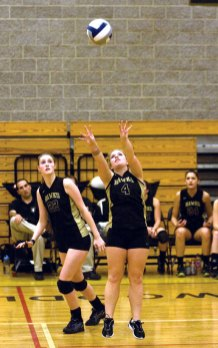 Woodland's Emily Wirsing (4) sets up the ball as Sam Edwon (22) looks for the kill in the Class M quarterfinals. Woodland finished the regular season perfect with an 18-0 record for the first time in school history. -FILE PHOTO