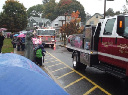 Students and staff from Laurel Ledge School in Beacon Falls greet firefighters and emergency personnel as they pull up to the school recently. Firefighters and emergency personnel from Beacon Hose Company No. 1 visited students the school's annual Fire Prevention Day during which students discussed ways to stay safe in the event of a fire at their homes. –CONTRIBUTED