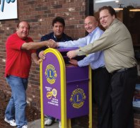 Prospect Lions Club members, from left, Mike Scaviola and Carl Montagano along with Dr. Thomas DeLuca and Dr. Anthony Marciano recently installed a new collection box in the front of DeLuca and Marciano's practice at 67 Prospect Road in Prospect. The mailbox-style collection container, with the Lions logo on it, replaced a weathered box and is used to recycling eyeglasses and hearing aids. –CONTRIBUTED