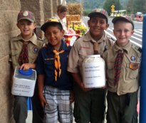 Cub Scouts from Naugatuck Pack 109 Mason Bedard, Jimmy Ayash, Tommy Ayash, and Matthew Steckert, sold popcorn during a fundraiser in front of Walmart on New Haven Road in Naugatuck Sept. 8. –CONTRIBUTED